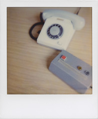 Tools of the trade (Stasi 1) (ale2000) Tags: white analog grey grigio desk telephone plastic 600 button instant analogue scrivania bianco stasi impossible i1 instantphotography redbutton analogico