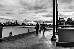 Rainy Day (Eric Bloecher) Tags: rain people women sky cloud clouds building wall pavement streetphotography blackwhite blackwhitephotos blackandwhite bw