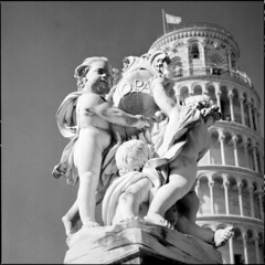 Fontana dei Putti (BG Sixtyniner) Tags: fontanadeiputti piazzadeimiracoli fountain angels historic monument centre pisa toscana italia landmark treasure giovanniantoniocybei marble white statue tower sculpture 17thcentury architecture blackwhite bw analog film roll mediumformat 120 square 6x6 hasselblad 500cm carlzeiss macroplanar f4 120mm cfi ilford hp5 expired microphen homedev 10 stock paterson redfilter canoscan 9000f vuescan