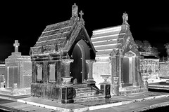 New Orleans Metairie Cemetery in the Rain (infrared negative) (dr_marvel) Tags: nola neworleans louisiana infrared ir cemetery mausoleum graves tombs burials negative blackandwhite urns vases cross christian pillars metairiecemetery black contrast