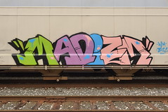 MADIZM (TheGraffitiHunters) Tags: graffiti graff spray paint street art colorful benching benched freight train tracks madizm hopper
