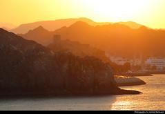 Mutrah seen from the Corniche, Muscat, Oman (JH_1982) Tags: sky evening sun glow sunset ocaso sonnenuntergang coucherdesoleil pôrdosol tramonto закат zonsondergang zachódsłońca solnedgång solnedgang auringonlasku apus залез matahariterbenam mặttrờilặn 日落 日没 غروب light yellow licht abend dusk dämmerung mountains mountain silhouette silhouettes city urban castle port harbour harbor hafen corniche كورنيش muttrah mutrah matrah مطرح 馬托拉 ムトラ 무트라 матрах muscat مسقط maskat mascate 马斯喀特 マスカット 무스카트 маскат oman sultanate سلطنة عُمان sultanat sultanato omán 阿曼 オマーン 오만 оман