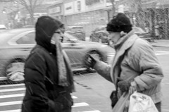 Conversation in the snow. (Capitancapitan) Tags: people pentax black white storm snow nyc neury luciano music manhattan conversation street photography