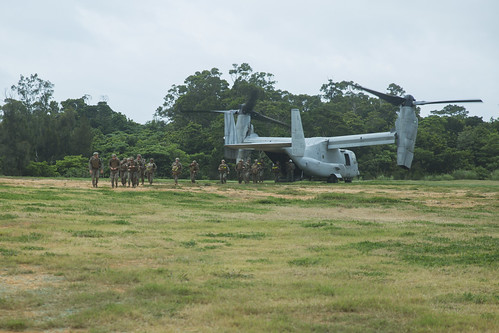 31st MEU Marines exit an MV-22B Osprey tiltrotor aircraft before a 10 kilometer hike in the Central Training Area, Okinawa