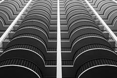 Curved Lines (Karen_Chappell) Tags: hotel architecture building balcony balconies waikiki honolulu hawaii oahu city urban abstract black white bw blackandwhite up perspective lines curves line curve railing pattern symmetry symmetrical geometry geometric