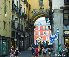 madrid010 (by claudine) Tags: capturedbylight l16 light16 architecture spain madrid los heroes del 7 de julio 1822 arch archway entrance square yellow orange tourism tourist people street sign storefront windows balconies plazamayor