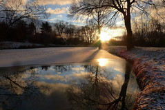 Sunrise with an ice layer (tatranka7) Tags: landscape reflections mirror sunrise morning trees sky clouds colors atmosphere water pond sun