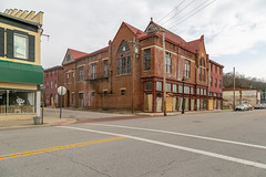 Building — Ripley, Ohio (Pythaglio) Tags: building structure historic ripley ohio unitedstatesofamerica us romanesque ornate twostory brick vacant abandoned browncounty monumental massive storefronts boarded parapeted 44windows stringcourse victoriangothic lancetarched 1893