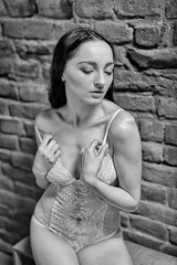 Dreaming (piotr_szymanek) Tags: magda magdaza woman young skinny studio blackandwhite face transparent lingerie legs brick wall longhair 1k 20f 50f 5k 10k