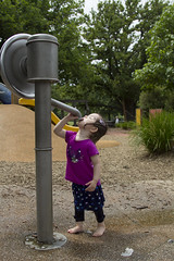 water mad (louisa_catlover) Tags: portrait family child daughter toddler tabitha tabby outdoor park playground water wet funny waterbaby drinking