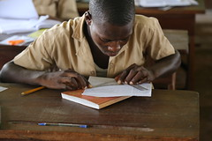 A student solves problems in class (Global Partnership for Education - GPE) Tags: gpe globalpartnershipforeducation benin education educationinbenin students desk notebook boy