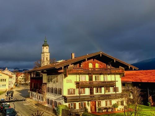 Rainbow in dark clouds over Kiefersfelden, Bavaria, Germany