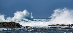 between (Wöwwesch) Tags: sky blue ocean boat sailing waves water rocks crashing spray interesting wet sunny between
