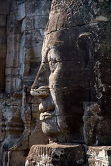 IMGP0929 Faces of Bayon (Claudio e Lucia Images around the world) Tags: angkor wat cambodia siem reap cambogia temple tempio khmer ancient asceta pentax pentaxkp pentax18135 pentaxlens pentaxart bayon entrance faces statue bridge naga stone heads angkorwat