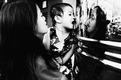 Their Own Reflection (Meljoe San Diego) Tags: meljoesandiego fuji fujifilm x100f streetphotography reflection children candid monochrome philippines