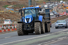 New Holland (Jungle Jack Movements (ferroequinologist)) Tags: new holland tractor trailer farm farmer power three point linkage tow land property harvest harvester reaper cutter mower strip combine thrasher crop yield produce return reap gather collect sow pick garner plant grow grain soil wheat oats barley field paddock truck market seasons summer acre tonne ton ship share fence dust dry flat silo hay feed bale load stack tinder track edinburgh scot scotland uk united kingdom forth road bridge construction