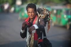 EL TALISMAN (N A Y E E M) Tags: hawker seller vendor candid portrait colors light afternoon street tigerpass chittagong bangladesh sooc windshield