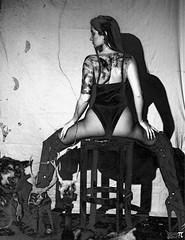 MelKristinCreep-11 (Onelog Photography) Tags: dark creepy blackandwhite smoke vintage spotlight shadow studio strobe grain latex dominatrix booty boobs cleavage wolf contrast