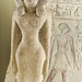 Limestone statuette of a woman standing against a pillar Middle Kingdom Egypt 1975 - 1640 BCE.