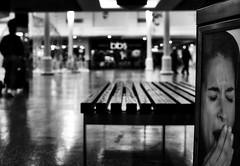 shopping again (Mallybee) Tags: blackandwhite bw mallybee apscbayer xmount mirrorless blackwhite shopping tired yawn poster boring fuji fujifilm xa1 bench bokeh neewer 25mm manual prime fujimount streetphoto f18