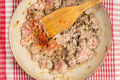 Mixing minced meat with paprika pepper and salt (wuestenigel) Tags: mincemeat woodenspatula redpaprika overview pork kitchenutensils domestickitchen cooking minced preparation porkmeat pepper paprika flatlay preparing food lebensmittel dinner abendessen meat fleisch kochen meal mahlzeit noperson keineperson lunch mittagessen delicious köstlich vegetable gemüse nutrition ernährung traditional traditionell dish gericht beef rindfleisch cuisine epicure feinschmecker healthy gesund hot heis closeup nahansicht plate teller herb kraut