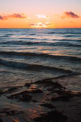 Lake Michigan Sunrise (Schwaco) Tags: lake michigan door county wisconsin harbor bay water ocean waves dawn morning rise early sun sunrise glow orange red purple blue shore coast beach sand reflection nature wild landscape cloudscape lakescape