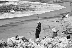 Fishing (mgschiavon) Tags: blackandwhite blackwhite bw people beach outdoors california