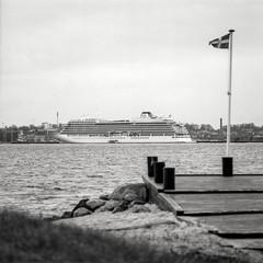 Fredericia set fra Strib, Fyn. Her ses Viking Sky, skibet som var i havsnød ud for den norske kyst her i foråret. Ser ud til at de har fået startet motorerne igen. (mgfoto2011) Tags: hasselblad2000fcw zeisssonnar250mmf56 expiredfilm ilforddelta100 selfdeveloped xtolreplenished minoltascanmultipro cruiseship