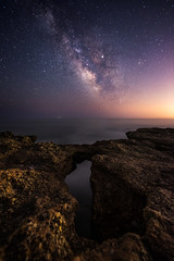 Over the hole (modesrodriguez) Tags: milkyway alcocebre alcossebre vialactea longexposure highiso 14mm f18 nightscape nightphotography night sea seascape rocks hole landscape spain sky stars universe planet lonely speck