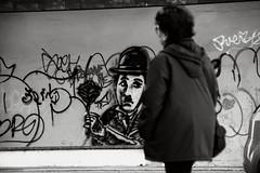 chaplin e signora (duegnazio) Tags: italia italy lazio roma rome duegnazio canon40d biancoenero blackandwhite chaplin muro murales streetphotography streetart people person woman donna