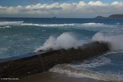 3KB10950a_C (Kernowfile) Tags: cornwall cornish pentax sennencove sennen breakwater rocks sky capecornwall island cliffs horizon sea waves breakingwaves spray foam sand beach clouds