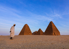 Old sudanese man in front of the meroitic pyramids of jebel Barkal, Northern State, Karima, Sudan (Eric Lafforgue) Tags: adultsonly africa ancientcivilization archaeology architecture blackpharaohs cemetery colorimage copyspace day desert famousplace fulllenght history horizontal jebelbarkal karima kushitic mausoleum men meroitic napatankings northsudan nubia oldruin onemanonly oneperson outdoors photography placeofburial pyramid ruined saharadesert sand senioradult sudan sudan180714 sunny sunset thepast tomb traditionalclothing tranquilscene traveldestinations unescoworldheritagesite northernstate