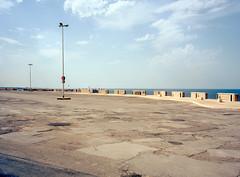 Polignano a Mare, Italy. (wojszyca) Tags: fuji gsw680iii 6x8 120 mediumformat fujinon sw 65mm kodak ektar 100 epson v800 city urban landscape offseason parking lot empty lamp sea coast tourism