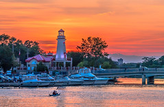 Sunset Paddle (Daniel Q Huang) Tags: boat sunset lighthouse lake clouds evening glow kayak colourful port dock marina