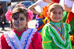 Bringing colors and smiles to the festival (radargeek) Tags: dayofthedead 2018 october plazadistrict okc oklahomacity facepaint catrina kid child flowers portrait skeleton he