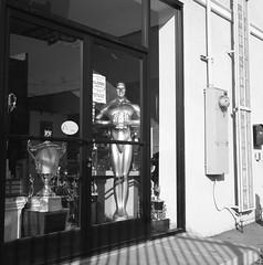 Oscars season (ADMurr) Tags: la smblvd oscar trophy hasselblad 500cm 50mm distagon fuji acros film square bw 6x6 dac869
