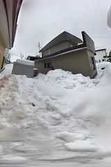 Snow and Ice on the Ground 5 (sjrankin) Tags: 20february2019 edited snow weather winter snowbank kitahiroshima hokkaido japan panorama neighborhood houses