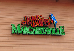 Sign At Jimmy Buffet's Margaritaville. (dccradio) Tags: myrtlebeach sc southcarolina horrycounty broadwayatthebeach jimmybuffet jimmybuffetsmargaritaville margaritaville restaurant food fun eat meal lunch supperdinner vacation travel tourism february monday mondayafternoon goodafternoon afternoon sign bird color colorful words text canon powershot elph 520hs