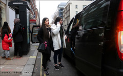 `2497 (roll the dice) Tags: london westminster westend w1 mad sad fun funny smile happy reaction streetphotography cold surreal girl pretty sexy people fashion weather angry shock canon tourism tourists colour portrait strangers candid urban unaware unknown uk classic crowd busy bored eyes face arab middleeastern lips mobile phone traffic lights taxi fare money