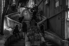 Crosstown traffic / a story on each and every step (Özgür Gürgey) Tags: 2019 bw camondo d750 jimihendrix karaköy nikon architecture grainy lowlight night people spiral stairs street istanbul 50mm