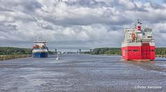 Kiel Canal / Nord-Ostsee-Kanal (peterkaroblis) Tags: kielcanal nordostseekanal ship schiff kanal canal wasser water wolken clouds brücke bridge blau blue red rot segelschiff sailingboat