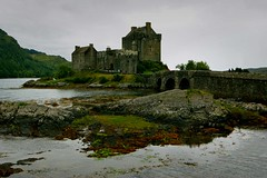 Grey day at the castle (WISEBUYS21) Tags: eilean donan castle scotland dornie kyle lochalsh tidal loch icon iconic recognisable highlands north west skye bridge duich alsh wisebuys21 grey water reflection sea weed rock stone fortress highlander