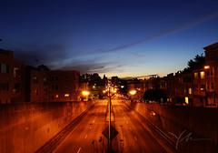 San-Francisco-sunset-view-from-Robert-C-Levy-Tunnel-overpass.jpg (yobelprize) Tags: horizon lines sunset overlook yobelmuchang buildings empty california contrast road bridge skylights sf emptyroad yobel overpass sanfrancisco lamps centered streetlights