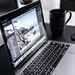 turned-on MacBook Pro on desk - Credit to https://myfriendscoffee.com/