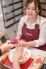 Young woman experiencing hand spa at nail salon (Apricot Cafe) Tags: img70105 adultsonly asia asianandindianethnicities canonef50mmf14usm expertise healthcareandmedicine healthylifestyle japan japaneseethnicity millennialgeneration tokyojapan artist beautyproduct beautyspa beautytreatment bodycare business businesswoman candid capitalcities carefree charming cheerful citylife colorimage confidence day experiencing fashion flower hand handspa indoors lifestyles nailpolish nailsalon nailist onlyjapanese onlywomen people photography professionaloccupation realpeople relaxing satisfaction smallbusiness smiling spa success twopeople women working youngadult
