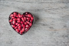 Close up color confection - Credit to https://homegets.com/ (davidstewartgets) Tags: closeup color confection delicious diet food fresh freshness fruit healthy heart juicy nutrition organic pomegranate red seeds shape sweet table tasty texture wooden