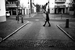 Just walking (Leica M6) (stefankamert) Tags: walking street film analog analogue grain blur blurry leica m6 leicam6 summaron 35mm kodak trix blackandwhite blackwhite bw baw lines noiretblanc noir rangefinder crossing road
