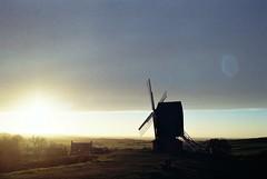 Brill WIndmill at Sunset (cycle.nut66) Tags: film kodak colr plus 200 analogue scan tamron 2825 olympus om2 sky clouds bright light sunlight 2019 classic brill windmill sunset horizon green fields