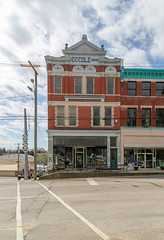 Cole Building — Carlisle, Kentucky (Pythaglio) Tags: building structure carlisle kentucky unitedstatesofamerica us historic threestory ornate nicholascounty sidewalk street storefront brick cole 1900 cornice brackets 11windows stringcourses classicalrevival modillions dentils quoins