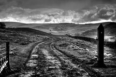 Rain Clouds (Missy Jussy) Tags: england rainclouds rain weather britishweather march 2019 piethornevalley sky clouds hills drystonewalls fence path mud grass fields view mono monochrome blackwhite bw blackandwhite ef70200mmf4lusm canoneos5dmarkii canon outdoor outside countryside landscape lancashire walkinglandscape northwest